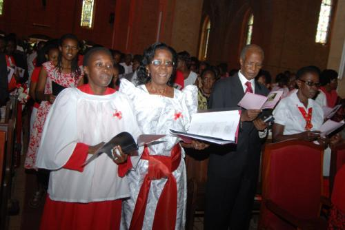 03A Mrs. Beatrice Geria & Mrs. Kiganda leading the choir